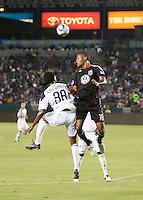 CARSON, CA – SEPTEMBER 18: LA Galaxy midfielder Alex Cazumba (88) and DC United defender Jordan Graye (16) during a soccer match at Home Depot Center, September 18, 2010 in Carson California. Final score LA Galaxy 2, DC United 1.