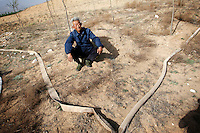 A worker waits whilst water is pumped through pipes to water dry farmland in Hebei Province, China. Desertification is the process by which fertile land becomes desert, typically as a result of drought, deforestation, or inappropriate agriculture. 41 % of China's landmass in classified as arid or desert. Inappropriate farming methods and over cultivation have contributed to the spreading of deserts in China in recent years.