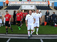 (L-R) Andy Robinson and Lee Trundle exit the tunnel during the Alan Tate Testimonial Match, Swansea City Legends v Manchester United Legends at the Liberty Stadium, Swansea, Wales, UK
