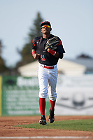 Batavia Muckdogs right fielder Brayan Hernandez (41) jogs to the dugout in between innings during the first game of a doubleheader against the Mahoning Valley Scrappers on August 28, 2017 at Dwyer Stadium in Batavia, New York.  Mahoning Valley defeated Batavia 6-3.  (Mike Janes/Four Seam Images)