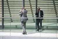 Mitglieder der CSU, telefonieren waehrend der Sitzung der CSU-Fraktion im Deutschen Bundestag.<br /> Nachdem es zwischen der CDU und der CSU zum Streit ueber den Umgang mit Fluechtlingen gab. Die Sitzung des Deutschen Bundestag wurde aufgrund dieses Streit auf Antrag der CDU/CSU-Fraktion fuer mehrere Stunden unterbrochen. Die Fraktionen von CDU und CSU tagten getrennt.<br /> 14.6.2018, Berlin<br /> Copyright: Christian-Ditsch.de<br /> [Inhaltsveraendernde Manipulation des Fotos nur nach ausdruecklicher Genehmigung des Fotografen. Vereinbarungen ueber Abtretung von Persoenlichkeitsrechten/Model Release der abgebildeten Person/Personen liegen nicht vor. NO MODEL RELEASE! Nur fuer Redaktionelle Zwecke. Don't publish without copyright Christian-Ditsch.de, Veroeffentlichung nur mit Fotografennennung, sowie gegen Honorar, MwSt. und Beleg. Konto: I N G - D i B a, IBAN DE58500105175400192269, BIC INGDDEFFXXX, Kontakt: post@christian-ditsch.de<br /> Bei der Bearbeitung der Dateiinformationen darf die Urheberkennzeichnung in den EXIF- und  IPTC-Daten nicht entfernt werden, diese sind in digitalen Medien nach ß95c UrhG rechtlich geschuetzt. Der Urhebervermerk wird gemaess ß13 UrhG verlangt.]