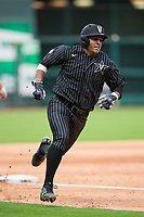 Jayson Gonzalez (99) of the Vanderbilt Commodores rounds third base during the game against the Sam Houston State Bearkats in game one of the 2018 Shriners Hospitals for Children College Classic at Minute Maid Park on March 2, 2018 in Houston, Texas.  The Bearkats walked-off the Commodores 7-6 in 10 innings.   (Brian Westerholt/Four Seam Images)