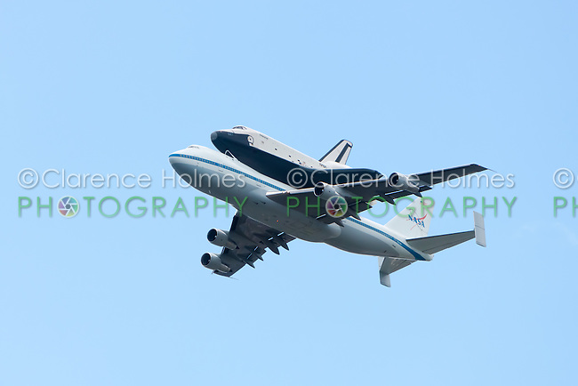 Space shuttle Enterprise, riding piggy-back on a 747, arrives in New York City, NY, USA on Friday, April 27, 2012.  The Enterprise was transferred from the Steven F. Udvar-Hazy Center in Chantilly, Virginia for permanent display at the Intrepid Sea, Air and Space Museum beginning in July.