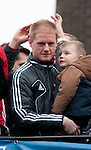 Alan Tate and  Swansea City Football team celebrate during an open-top bus parade through the centre of Swansea after beating Bradford City 5-0 in Sunday's Capital One Cup final at Wembley to win the Capital Cup trophy.