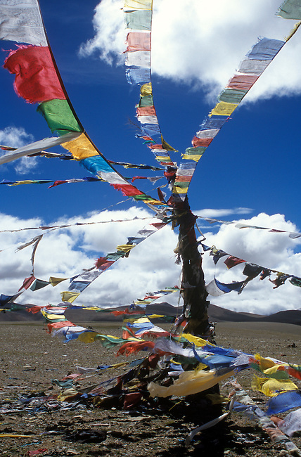PRAYER FLAGS fly atop the LALUNG LA (PASS) at over 17,000 feet in elevation along the FRIENDSHIP HIGHWAY - TIBET