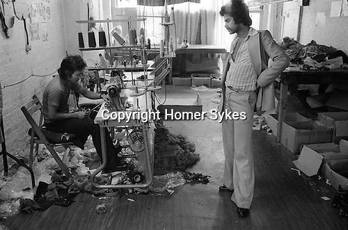 Asian sweatshop rag trade workshop east London 1970s. Owner and worker.