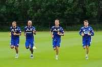 Motion blur of Adel Taarabt, Armand Traore , Clint Hill and Jamie Mackie of QPR in training