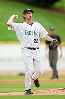 Charlotte Knights starting pitcher Matt Zaleski (22) makes a throw to first base against the Syracuse Chiefs at Knights Stadium on August 29, 2012 in Fort Mill, South Carolina.  (Brian Westerholt/Four Seam Images)