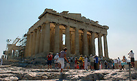 Tourists roam the grounds at the Acropolis in Athens, Greece Thursday August 12, 2004. The historic Acropolis is visible from most of the city. (Alan Greth)
