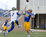 BROOKINGS, SD - MAY 8: Adam Bock #32 from the South Dakota State Jackrabbits closes in on quarterback Nolan Henderson #2 of the Delaware Fightin Blue Hens on May 8, 2021 in Brookings, South Dakota. (Photo by Dave Eggen/Inertia)