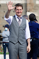 Actor Tom Cruise smiling and waving to his fans  on the set of the film Mission Impossible 7 at Imperial Fora in Rome. <br /> Rome (Italy), October 12th 2020<br /> Photo Samantha Zucchi Insidefoto
