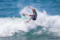 Huntington Beach, CA - Tuesday July 31, 2018: Ricardo Christie in action during a World Surf League (WSL) Qualifying Series (QS) Men's round of 96 heat at the 2018 Vans U.S. Open of Surfing on South side of the Huntington Beach pier.