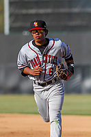 Quad Cities River Bandits infielder Rodrigo Ayarza (6) runs into the dugout between innings of a Midwest League game against the Wisconsin Timber Rattlers on April 8, 2017 at Fox Cities Stadium in Appleton, Wisconsin.  Wisconsin defeated Quad Cities 3-2. (Brad Krause/Four Seam Images)