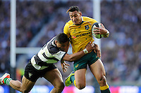 Israel Folau of Australia is tackled by Frank Halai of Barbarians during the Killik Cup match between Barbarians and Australia at Twickenham Stadium on Saturday 1st November 2014 (Photo by Rob Munro)