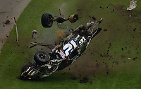 The racecar of NASCAR Winston Cup Series driver Ryan Newman disintegrates as he crashes on lap #57 of the Daytona 500 at Daytona International Speedway in Daytona Beach, Fl.