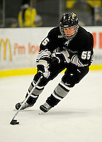 30 December 2007: Western Michigan University Broncos' right wing forward Matt Clackson, a Junior from Pittsburgh, PA, in action against the Holy Cross Crusaders at Gutterson Fieldhouse in Burlington, Vermont. The teams skated to a 1-1 tie, however the Broncos took the consolation game in a 2-0 shootout to win the third game of the Sheraton/TD Banknorth Catamount Cup Tournament...Mandatory Photo Credit: Ed Wolfstein Photo