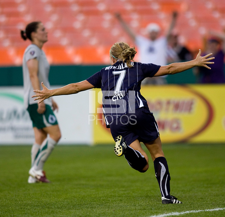 Lene Mykjaland (7) of the Washington Freedom celebrates her goal with Kendall Fletcher (4) of the Saint Louis Athletica in the background at RFK Stadium in Washington, DC.  The Washington Freedom defeated Saint Louis Athletica, 3-1.