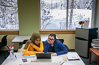 Students Sultana Jones, left, and Makayla Cudmore, right, work on homework in UAA's Multicultural Center in Rasmuson Hall.