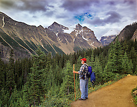 Hiker on path to Agnes Lake. Banff National Park, Canada