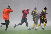 Woodgrange Rangers FC players run for cover during a hailstorm at Hackney Marshes - 22/11/09 - MANDATORY CREDIT: Gavin Ellis/TGSPHOTO - Self billing applies where appropriate - Tel: 0845 094 6026