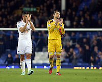 Liverpool, UK. Saturday 01 November 2014<br /> Pictured L-R: Swansea players Neil Taylor and Lukasz Fabianski  thank their away supporters as they walk off the pitch after the end of the game. <br /> Re: Premier League Everton v Swansea City FC at Goodison Park, Liverpool, Merseyside, UK.