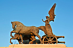 The Quadriga dell'Unita; horses and winged victory statue on top of the Altare della Patria monument in Rome; quadriga is a chariot drawn by 4 horses