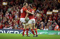 Pictured: Hallam Amos of Wales celebrates his try with team mate Dominic Day Sunday 20 September 2015<br /> Re: Rugby World Cup 2015, Wales v Uruguay at the Millennium, Stadium, Wales, UK