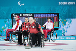 Sochi, RUSSIA - Mar 8 2014 -  Jim Armstrong takes a shot as Canada takes on Russia in Wheelchair Curling during the 2014 Paralympic Winter Games in Sochi, Russia.  (Photo: Matthew Murnaghan/Canadian Paralympic Committee)