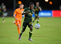 LAKE BUENA VISTA, FL - JULY 18: Yimmi Chará #23 of the Portland Timbers runs onto a pass during a game between Houston Dynamo and Portland Timbers at ESPN Wide World of Sports on July 18, 2020 in Lake Buena Vista, Florida.