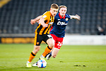 Hull City midfielder Greg Docherty goes past Sunderland's Carl Winchester, a long exposure with motion blur. Hull 2 Sunderland 2, League One 20th April 2021.