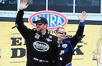 Apr. 29, 2012; Baytown, TX, USA: NHRA top fuel dragster driver Shawn Langdon (front) with Brandon Bernstein during the Spring Nationals at Royal Purple Raceway. Mandatory Credit: Mark J. Rebilas-