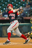 C.J. Cron #24 of the Utah Utes follows through on his swing against the Baylor Bears at Minute Maid Park on March 5, 2011 in Houston, Texas.  Photo by Brian Westerholt / Four Seam Images