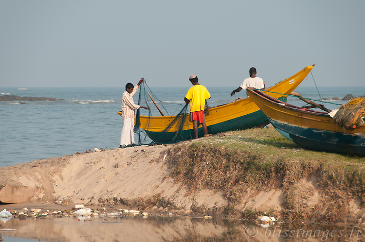 Fishing nets are sorted for the next sortie at Beruwala fishing village, Sri Lanka