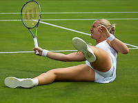 London, England, 30 june, 2016, Tennis, Wimbledon, Kiki Bertens (NED) returns the ball after she has fallen on the grass in her match against Mona Barthel (GER)<br /> Photo: Henk Koster/tennisimages.com