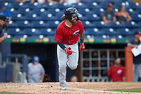 Eric Haase (13) of the Columbus Clippers hustles down the first base line against the Durham Bulls at Durham Bulls Athletic Park on June 1, 2019 in Durham, North Carolina. The Bulls defeated the Clippers 11-5 in game one of a doubleheader. (Brian Westerholt/Four Seam Images)