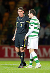 St Johnstone v Celtic..27.10.10  .Ref Craig Thomson has words with Anthony Stokes.Picture by Graeme Hart..Copyright Perthshire Picture Agency.Tel: 01738 623350  Mobile: 07990 594431