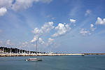 A sailing boat leaving the harbor area at the Maritime Festiville in Port Washington Wisconsin