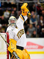 18 October 2009: University of Vermont Catamount goaltender Rob Madore, a Sophomore from Venetia, PA, indicates an icing call during a game against the Boston College Eagles at Gutterson Fieldhouse in Burlington, Vermont. The Catamounts defeated the Eagles 4-1 to open Vermont's America East hockey season. Mandatory Credit: Ed Wolfstein Photo