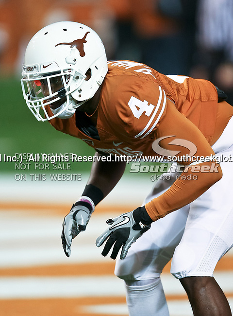 Texas Longhorns cornerback Aaron Williams (4) warms up before the game between the Oklahoma State Cowboys and the University of Texas in Austin Texas Longhorns at the Daryl K. Royal- Texas Memorial Stadium in Austin, Texas. The Oklahoma State Cowboys defeated the Texas Longhorns 33 to 16.