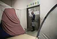 Pictured: The english language teacher enters the class Monday 06 February 2017<br /> Re: A school teaching the English language has been operating at the migrant camp located in the former airport in the outskirts of Athens, Greece.