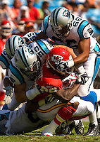 Carolina Panthers defensive end Hilee Taylor (66) and Julius Peppers tackle a Kansas City Chiefs player during a NFL football game at Bank of America Stadium in Charlotte, NC.
