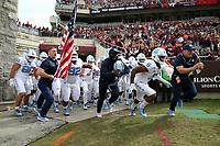 BLACKSBURG, VA - OCTOBER 19: Dazz Newsome #5 of the University of North Carolina leads his team onto the field during a game between North Carolina and Virginia Tech at Lane Stadium on October 19, 2019 in Blacksburg, Virginia.