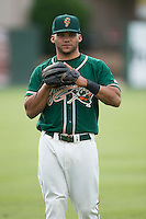 Justin Twine (1) of the Greensboro Grasshoppers warms up in the outfield prior to the game against the Kannapolis Intimidators at CMC-Northeast Stadium on June 9, 2015 in Kannapolis, North Carolina.  The Intimidators defeated the Grasshoppers 6-4.  (Brian Westerholt/Four Seam Images)