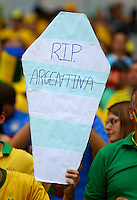 A Brazil supporter holds a coffin with the colours of rivals Argentina and 'RIP Argentina' on
