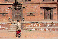 Bhaktapur, Nepal.  Woman Walking Wearing the Traditional Red and Black Worn by Bhaktapur Women.