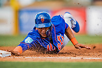 28 February 2019: New York Mets outfielder Juan Lagares dives safely back to first during the 4th inning of a Spring Training game against the St. Louis Cardinals at Roger Dean Stadium in Jupiter, Florida. The Mets defeated the Cardinals 3-2 in Grapefruit League play. Mandatory Credit: Ed Wolfstein Photo *** RAW (NEF) Image File Available ***