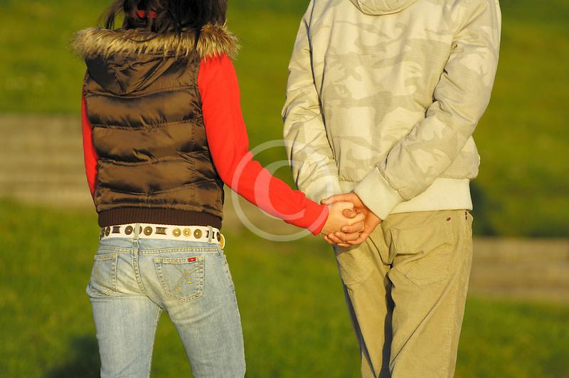 Poland, Krakow, Couple walking holding hands