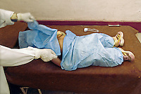 Baghdad, Iraq, April 5, 2003.A doctor of the Al Kindi hospital emergency ward covers up the body of Ali Jamal bachir, 2,  killed in his home in Ubeidi by a US bomb.war. More than 70 US bombardment victims were admitted in less than 2 hours after a B52 carpet bombing on the Northern outskirts, about a fifth of these were military personel.