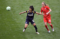 LA Sol's Han Duan and Washington Freedom's Becky Sauerbrunn. The LA Sol defeated the Washington Freedom 2-0 in the opening game of Womens Professional Soccer at Home Depot Center stadium on Sunday March 29, 2009.  .Photo by Michael Janosz