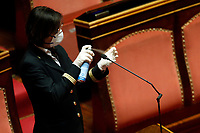 Clerks of the Senate, wearing masks and gloves, disinfecting microphones<br /> Rome March 26th 2020. Senate. Information of the Italian Premier about the measures adopted to contrast Coronavirus, Covid-19.<br /> Photo Samantha Zucchi Insidefoto